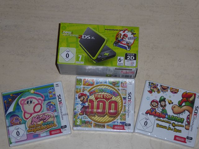 New Nintendo 2DS XL inkl. Mario Kart 7 + andere Spiele